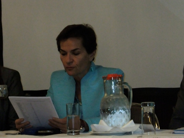 Christiana Figueres reading the report 'Levelling the Playing Field'